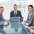 Smiling business people working together with their laptop — Stock Photo