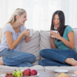 Friends laughing and drinking coffee together — Stock Photo #29454781