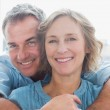 Happy man hugging his wife from behind — Stock Photo