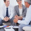 Cheerful business people talking and working together on sofa — Stock Photo #29455073