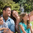 Happy family in a park taking photos — Stock Photo