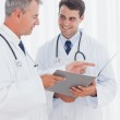 Smiling doctors interpreting results together — Stock Photo