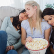 Friends dozing together on the couch — Stock Photo