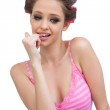 Sexy young model posing wearing hair curlers — Stock Photo