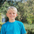 Blonde boy smiling at camera — Stock Photo