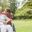 Granddaughter hugging grandmother in wheelchair — Stock Photo