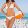 Sexy body in white bikini with beach ball — Stock Photo