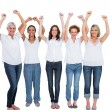 Cheerful casual models posing with hands up — Stock Photo