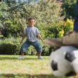 Stock Photo: Son standing as goal keeper with dad
