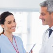 Nurse talking with doctor — Stock Photo #29458339