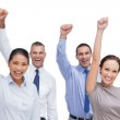 Cheerful work team posing with hands up — Stock Photo