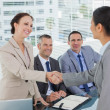 Stock Photo: Young pretty applicant shaking hands with future employers