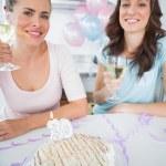 Cheerful women with white wine and birthday cake — Stock Photo
