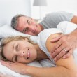 Couple lying in bed spooning — Stock Photo