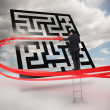 Businessman on ladder tracing red line through qr code — Stock Photo