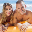 Happy cute couple in swimsuit posing — Stock Photo