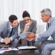 Business people working together on sofa — Stock Photo