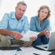 Worried couple paying their bills online with laptop — Stock Photo #29459455