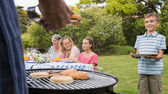 Little boy waiting for barbecue cooked by father — Stock Photo