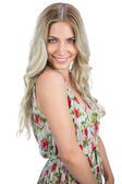 Happy attractive blonde wearing flowered dress posing — Stock Photo