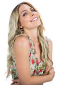 Cheerful seductive blonde wearing flowered dress posing — Stock Photo