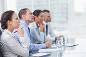 Thoughtful coworkers listening to presentation — Stock Photo