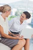 Businesswomen laughing while working together — Stock Photo