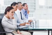 Businesswoman getting bored while attending presentation — Stock Photo