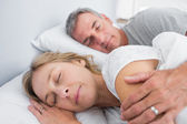 Calm couple sleeping and spooning in bed — Stock Photo