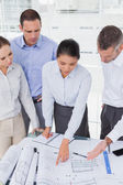 Focused architects interacting and analyzing plans together — Stock Photo