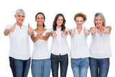 Cheerful casual models posing together with thumbs up — Stock Photo