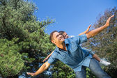 Father and son playing in a park — Stock Photo