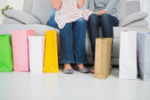 Plenty of colorful shopping bags on the floor — Stock Photo