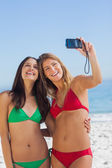 Two sexy friends taking pictures of themselves — Stock Photo