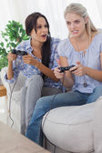Young friends playing video games and having fun — Stock Photo