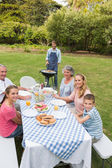 Cheerful extended family having a barbecue — Stock Photo