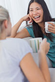 Friends drinking coffee and having a chat — Stock Photo