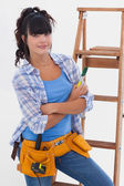 Young woman ready for home improvement — Stock Photo