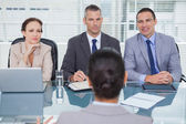 Business team listening to the applicant in interview — Stock Photo