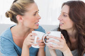 Friends talking while having coffee — Stock Photo