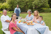 Happy extended family having a barbecue being cooked by father — Stock Photo