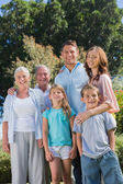 Happy family and grandparents in the countryside — Stock Photo