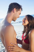 Cheerful cute couple in swimsuit holding one another — Foto Stock