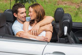 Couple in love cuddling in the backseat and chatting — Stock Photo