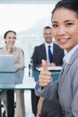 Young pretty applicant showing thumb up after obtaining the job — Stock Photo