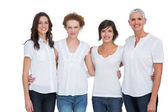 Cheerful women posing with white tops — Stock Photo