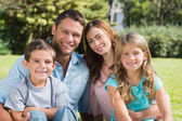 Family enjoying the sun — Stock Photo