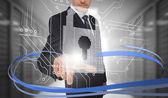 Uomo d'affari toccando il blocco sull'interfaccia futuristica con vorticoso — Foto Stock