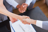 Salesman shaking hand with client — Stock Photo