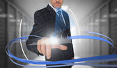 Businessman touching graph on futuristic interface with swirling — Stock fotografie